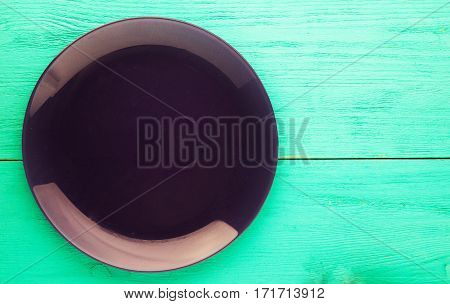 Plate On A Wooden Background.purple Plate. Plate Top View. Copy Space