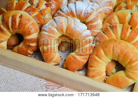 Fresh sweet buns . Freshly baked sweet buns or bread rolls with black sweet poppy for breakfast and tea or coffee time, closeup