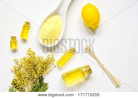 Cosmetic set for spa with essential oil and sea salt on white table background top view