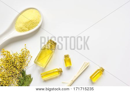 Cosmetic set with essential oil and sea salt on white table background top view mockup