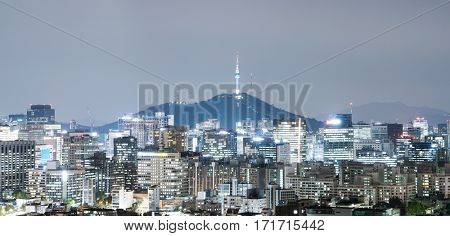 cityscape and skyline of seoul near hill at twilight