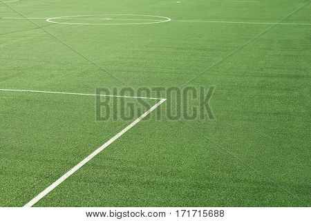 green synthetic sport soccer field surface closeup
