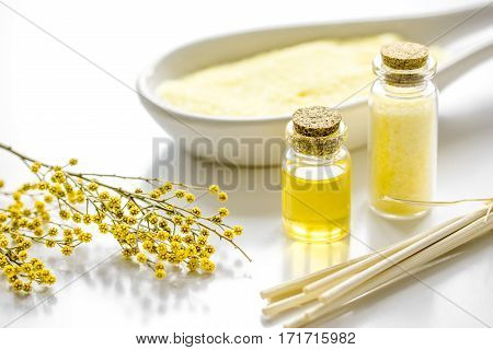 Home cosmetic set with organic essential oil and sea salt on white background