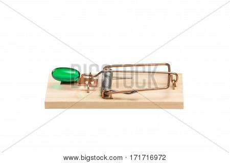 Green gelatin capsule or pill as bait in a mousetrap. Studio close-up isolated on white. Concepts could include addiction desire danger risk others.