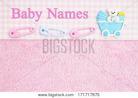 Old fashion pink baby names background with baby diaper pins and a baby carriage with text Baby Names