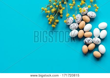 Easter eggs with blossom branch postcard on blue background top view mockup