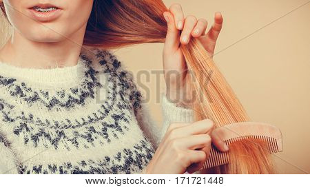 Teenage Blonde Girl Brushing Her Hair With Comb