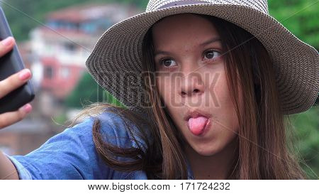 Teen Girl Making Goofy Funny Faces For Selfy