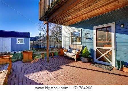 Exterior Of Blue Craftsman House With Covered Back Porch