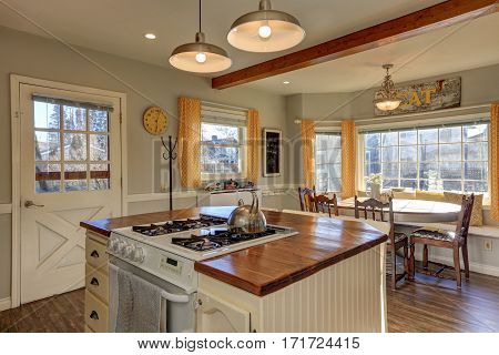 Newly Renovated Kitchen And Breakfast Nook  With Wood Beams On Ceiling