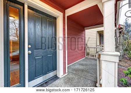 Covered Red Porch With Dark Blue Accent Front Door