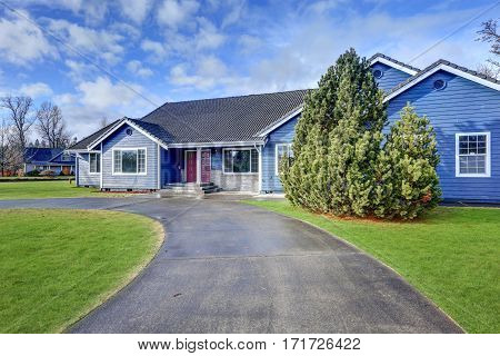 Beautiful Blue Rambler House With Tile Roof