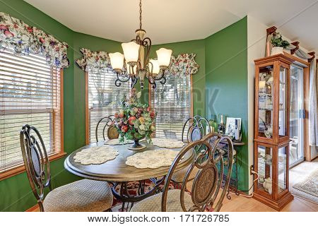 Amazing Bright Green Breakfast Nook Boasts Wrought Iron Table Set