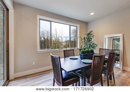 Neutral Dining Room Interior Fitted With Black Dining Table