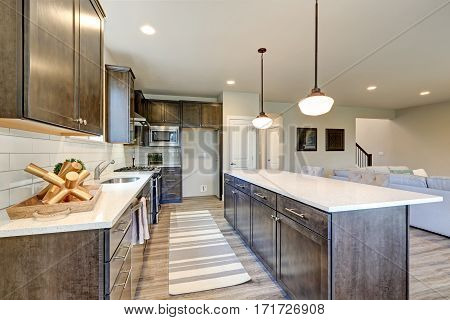 New Kitchen Boasts Dark Wood Cabinets, Large Island