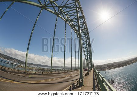 Yaquina Bay Bridge in Newport Oregon USA. Sunny summer day on the Pacific Ocean at the famous bridge commonly called Newport Bridge.