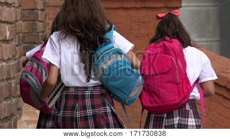 A Group of Teen Girl Students With Backpacks