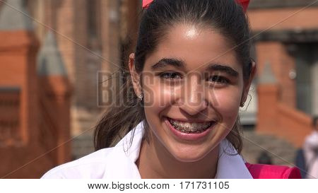 A Pretty Smiling Teen Girl With Braces