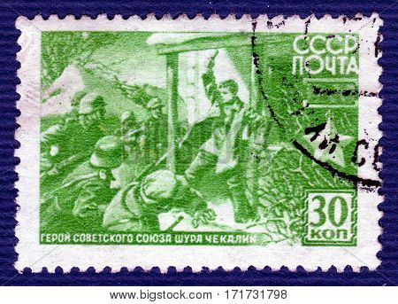 USSR - CIRCA 1944: Postage stamp  printed in USSR  with a portrait of  Shura Chekalin (1925-1941), the young scout partisans during Great Patriotic War, Hero of the Soviet Union. circa 1944