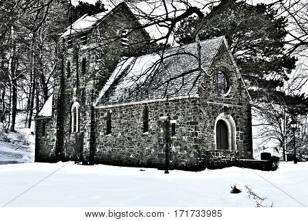 The Ellingwood Chapel in Nahant Massachusetts, a Gothic Revival structure built in 1920.The cemetery was established in 1856 shown here snow covered