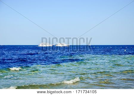 Ships Are Sailing On The Waves Off The Coast. Egypt, Sharm El Sheikh.