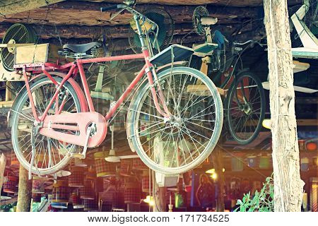 Vintage bicycle hanging and abstract background. Old bicycle hanged background