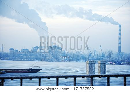 Industrial winter landscape with a view of industrial center