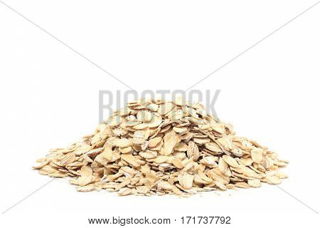 Oat flakes pile on a white background