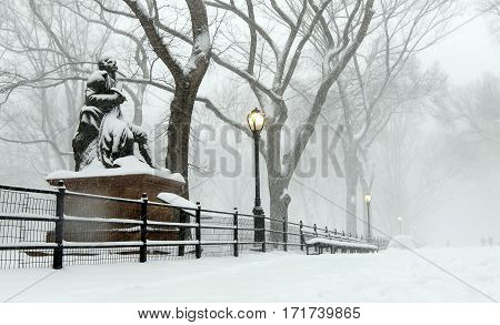 Sculpture Of Robert Burns In Central Park During A Snowfall.