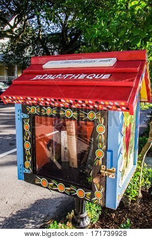 New Orleans, Louisiana - July 13, 2015: Mini little free library bibliotheque in downtown