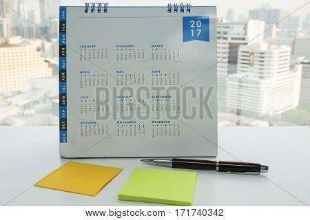 close up 2017 calendar with mock up postit for arranging meeting