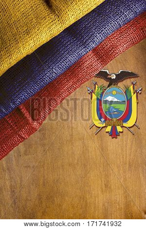 The state flag of Ecuador on a wooden background