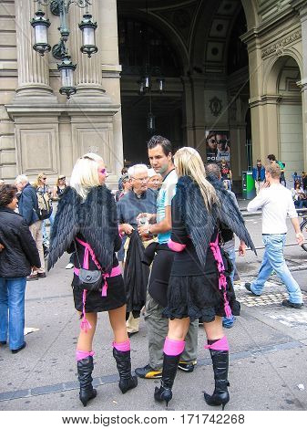 Zurich, Switzerland - August 11, 2008: Techno parade with women in black angel costumes