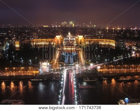 Aerial view of Palais de Chaillot palace from Eiffel Tower illuminated at night