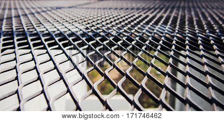 Shade of black metal mesh floor land scape