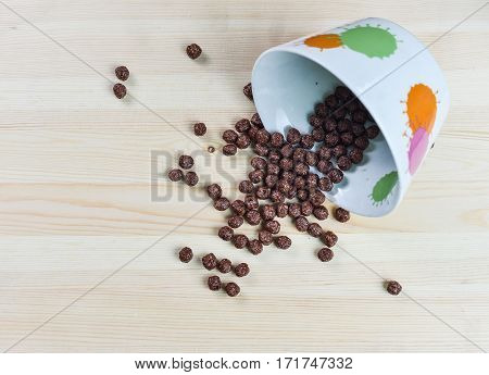 Cereal chocolate balls and glass of milk on breakfast