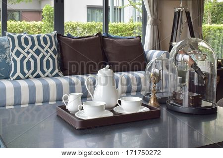 Decorative Tray Of Tea Cup On Wooden Table In Luxury Living Room Interior