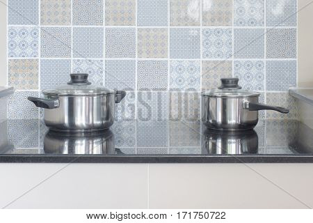 Stainless Steel Pots On Electric Hob In The Kitchen