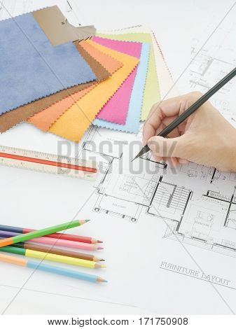 View Of Hand Writing  On Architectural Drawing With Fabric Sample, Scale And Color Pencil