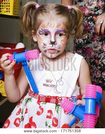 little girl with faceart on birthday party, lifestyle people concept close up