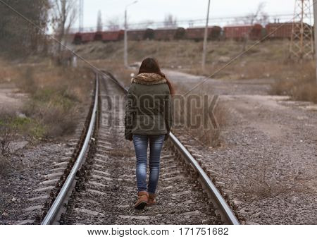 Depressed young woman on railroads