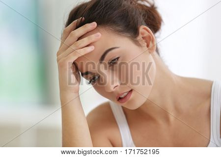 Depressed young woman at home, closeup