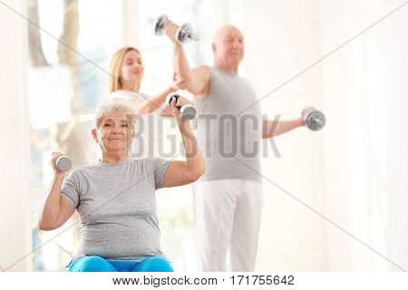Elderly patient training in rehabilitation center