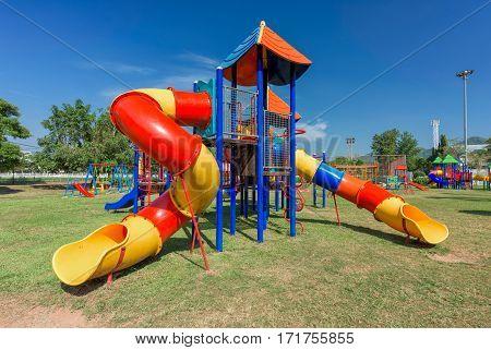 Modern children playground in park with blue sky