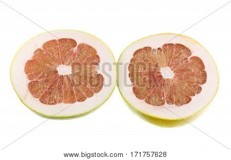 Pink flesh of a pomelo citrus maxima on white background