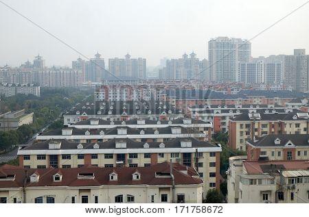 SHANGHAI, CHINA - FEBRUARY 26: Shanghai city at morning in foggy day in Shanghai, China on February 26, 2016.