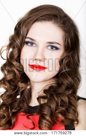 portrait of young beautiful woman with dental braces holding sugarplum.