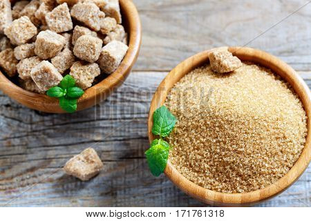 Small Crystals Of Brown Sugar In A Wooden Bowl.