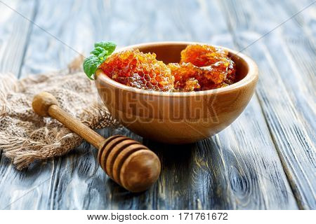 Wooden Bowl With Honey In The Comb.
