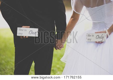 Bride and groom with two thematic labels
